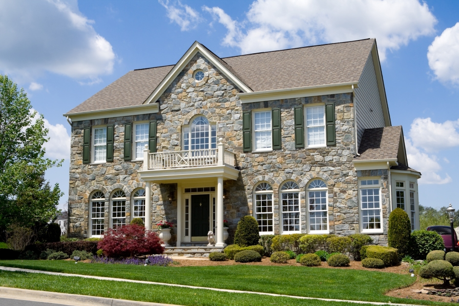 Well landscaped stone single family house.  Home is a center hall colonial in suburban Maryland, United States.  - see my lightbox for more house images.